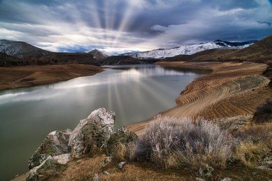 sunrays over lucky peak reservoir near boise idaho