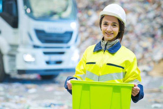 recycling factory site worker smiling