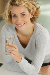 happy young woman drinking water