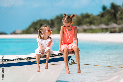 b76c2b099d032 Two little happy girls have a lot of fun at tropical beach playing together