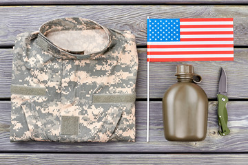 American soldier necessities, flat lay. Top view, wooden background.