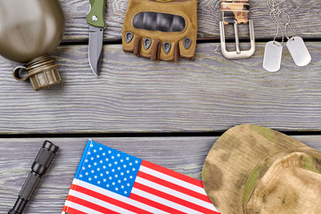 Set of patriotic american army soldier accessories. Wooden desk background.