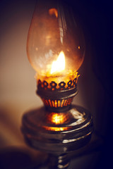 Beautiful burning vintage old kerosene lamp