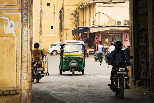 City life with Auto rickshaw (also known as Tuc Tuc) and motorbikes through the streets of Jaipur. Jaipur is the capital of the Indian state of Rajasthan, India.