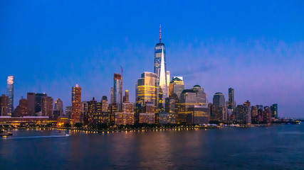 Fototapete - New York City Skyline with Skyscrapers Illuminated at Dusk
