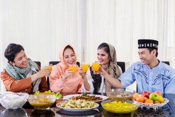 Happy people toast before breaks the fast together