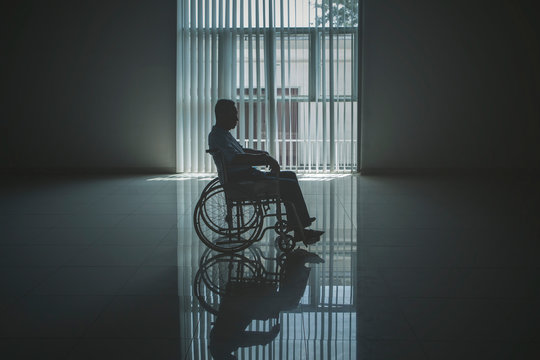 Lonely elderly man looks sad in the wheelchair