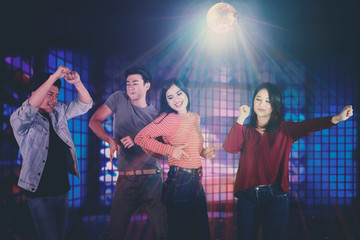 Young Asian people dancing in the nightclub