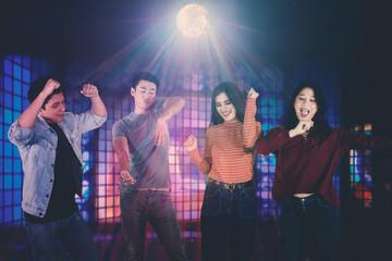 Young Asian people having fun in the nightclub