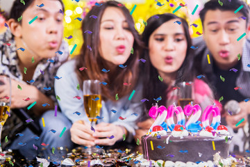 Young people blow candles with numbers 2020