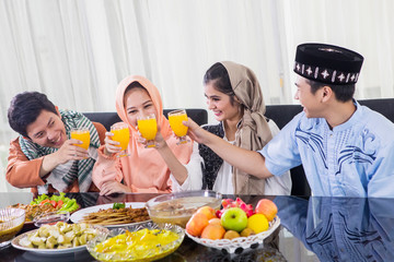 Young people toast during breaks the fast