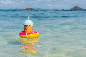 Tropical drinks floating on tropical sea with copy space, Summer vacation and travel concept