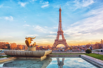 Eiffel Tower at sunset in Paris, France. Romantic travel background Wall mural