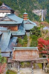 Fototapete - Scenic view of Seiganto-ji Temple with Nachi no Taki fall in background at Nachi Katsuura, Wakayama, Japan