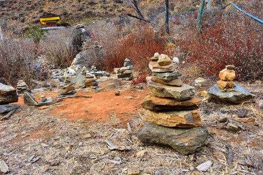 Stones piled up in prayer offerings in Paro, Bhutan.