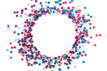 4th of July American Independence Day. Red, blue and white star confetti decorations on white background. Flat lay, top view, copy space