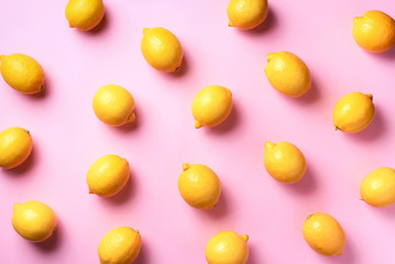 Food pattern with lemons on pink paper background. Top view. Summer concept. Vegan and vegetarian diet