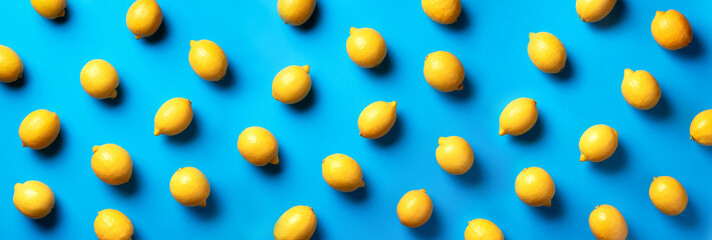 Food pattern with lemons on blue paper background. Top view. Summer concept. Vegan and vegetarian diet. Banner