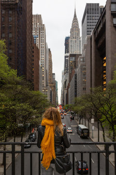 Woman looking at avenue in New York