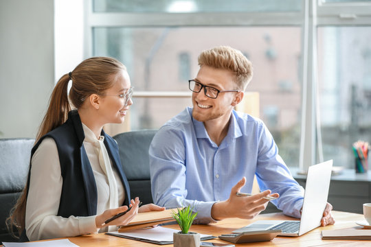 Male and female accountants working in office