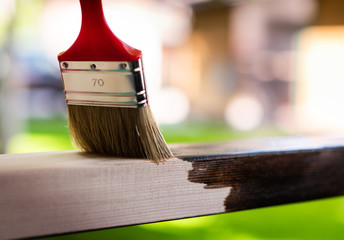 Painting wooden surface with a brush