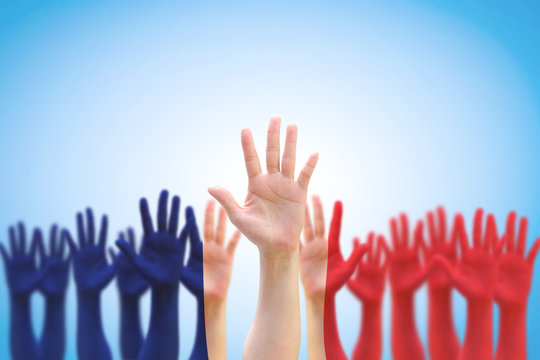 France national flag pattern on people palm hands raising up on blue sky background