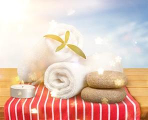 Spa concept with zen basalt stones and towels