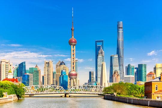 Shanghai pudong skyline with historical Waibaidu bridge, China during summer sunny day