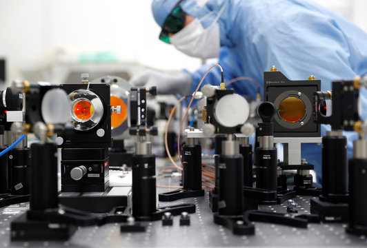 A technican of Trumpf, a hidden Champion of the German Mittelstand that supplies CO2 laser technology to Dutch ASML and the leader of semiconductor lithography machines, adjusts optical parts for one of their CO2 lasers at the Trumpf headquarters in Ditzin