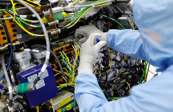 A technican of Trumpf, a hidden Champion of the German Mittelstand that supplies CO2 laser technology to Dutch ASML and the leader of semiconductor lithography machines, adjusts one of their CO2 lasers at the Trumpf headquarters in Ditzingen