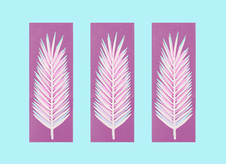 Wall Mural - Purple paper palm leaves on blue background. Creative layout. Summertime