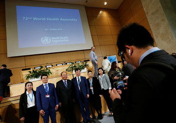 Delegates pose for a picture on the opening day of the 72nd World Health Assembly in Geneva