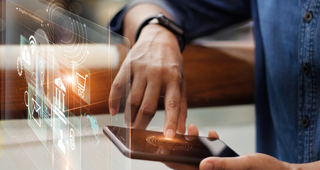 Digital marketing media and mobile payments. Businessman working with mobile smartphone and icon network connection on virtual screen. Online banking. Business and modern technology.