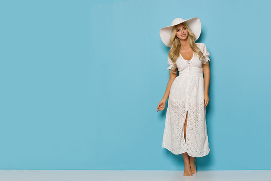 Relaxed Pretty Woman In White Summer Dress And Sun Hat