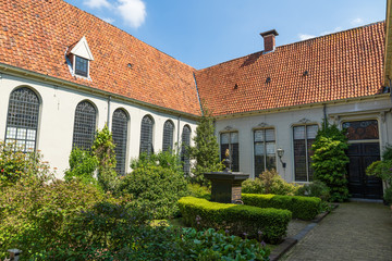 Old public courtyard at the 'Pepergasthuis' in the Dutch city of Groningen on a spring day.