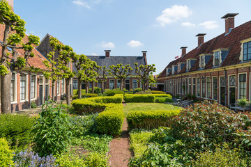 Old public courtyard and almshouses of 'Pepergasthuis' in the Dutch city of Groningen on a spring day.