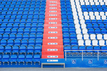 Blue empty seats on the tribune of the new stadium.