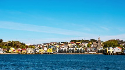 Wall Mural - Kristiansund, Norway. View of city center of Kristiansund, Norway during the sunny day. Port with historical buildings, zoom in