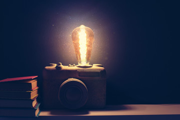 A vintage lamp made as an old film camera on cement background