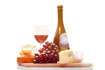 Wine Bottle, Wine Glass, Cheese and Grape on the Wooden Platter