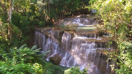 Wall Mural - Waterfall flow standing with forest enviroment high angle view in thailand called Huay or Huai mae khamin in Kanchanaburi Provience, Thailand., Zoom out.