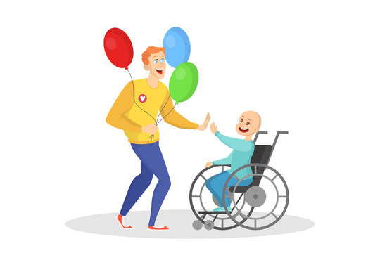 Volunteer playing with a child in a wheelchair