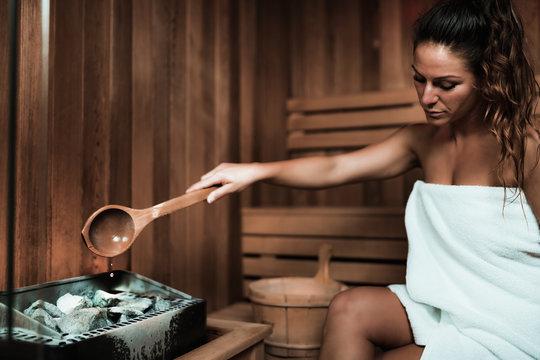 Woman Relaxing in Sauna.