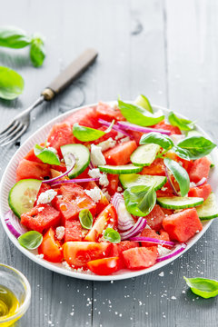Summer salad with watermelon and salad leaves