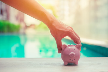 Pig Bank, Hand Holding, Personal finance money saving concept