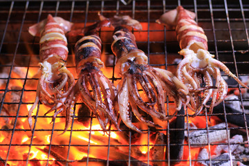 Squid BBQ grill on hot charcoal hot fire tasty delicious sea food