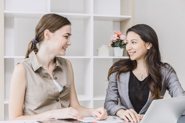 two office business girl looking together smiling enjoy working in office