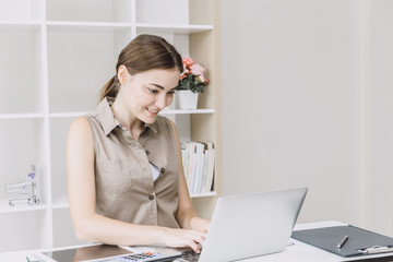 Business woman office girl enjoy working on desk with laptop smiling