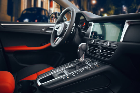 Expensive and luxury car interior with steering wheel, multimedia and gearbox handle