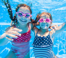 Children swim in  pool